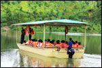 All aboard for a river boat ride in the tranquil lake and watch the fish hop around for food along the journey.